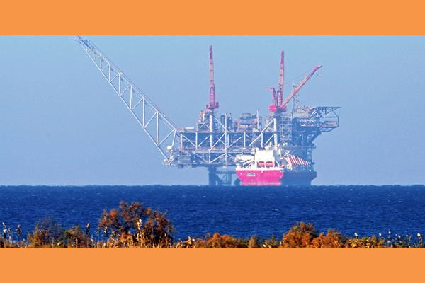 A View Of The Platform Of The Leviathan Natural Gas Field In The Mediterranean Sea Is Pictured From The Israeli Northern Coastal City Of Caesarea On December 19, 2019. - Israel Has Approved The Export Of Gas From Its Offshore Reserves To Egypt, A Spokeswoman Said On December 17, With A Major Reservoir Expected To Begin Operations Imminently. The Approval By Energy Minister Yuval Steinitz Was Part Of A Long Process Under Which Israel Will Transform From An Importer Of Natural Gas From Egypt Into An Exporter And Potential Regional Energy Player. (Photo By JACK GUEZ / AFP) (Photo By JACK GUEZ/AFP Via Getty Images)